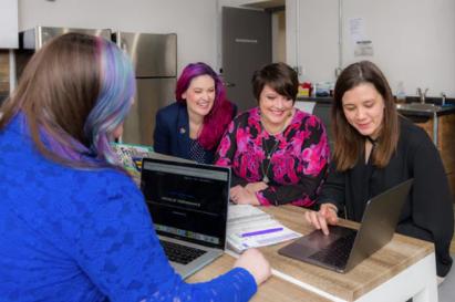 Four women using recruiting software